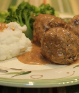 Swedish meatballs, gravy, mashed potatoes and broccoli on a plate
