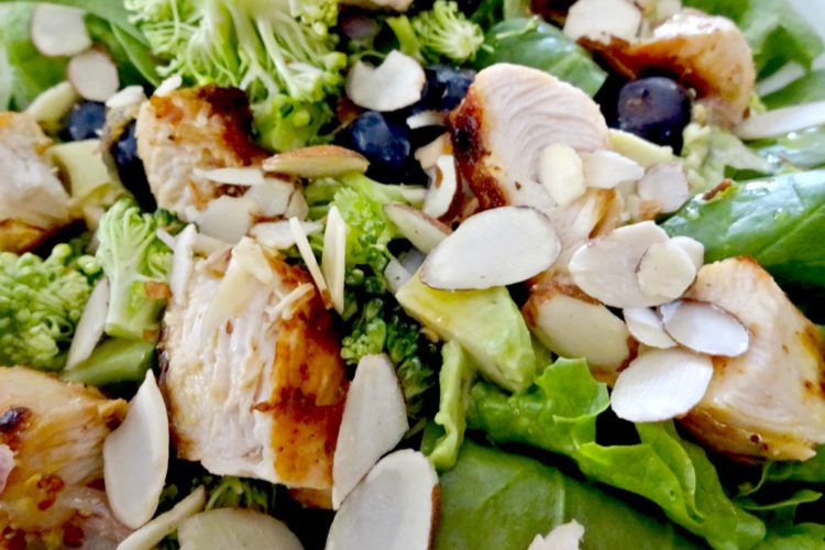 This chicken salad is loaded with good for you whole food ingredients and it is dressed with a light citrus dressing.