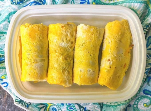 4 Freezable Low Carb Sausage Egg Rolls on a platter