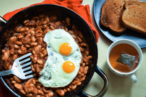 Baked Beans and sunny side eggs in a skillet