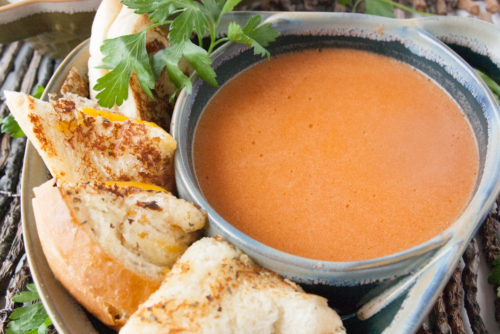 Tomato Soup surrounded by grilled cheese