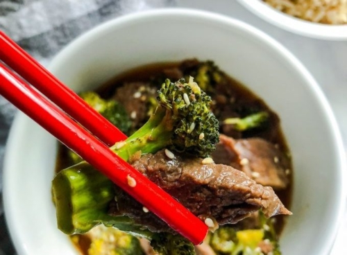 Beef and Broccoli in a bowl with chopsticks