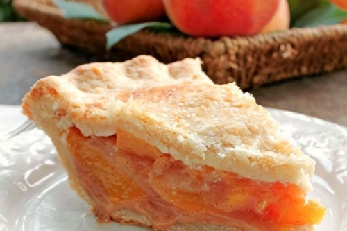 one slice of Peach Pie on a plate
