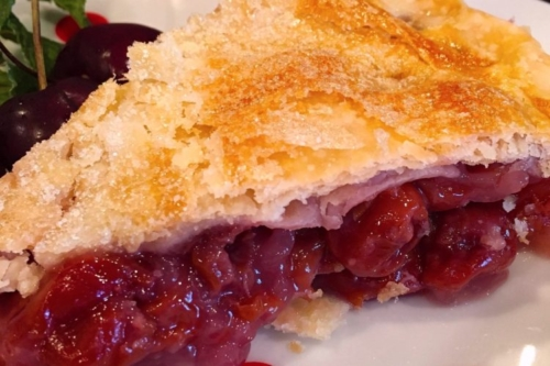 a slice of cherry pie on a plate
