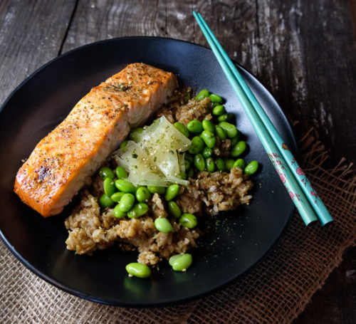 Brown Rice Bowl with Salmon and Edamame on a plate