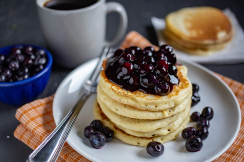 stacked Buttermilk Pancakes with Blueberry Sauce on a plate