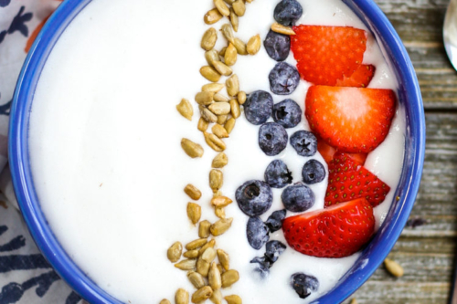 Dairy Free Instant Pot Yogurt in a large bowl with berries
