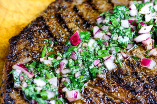 Flank Steak with Chimichurri Sauce down the middle of it