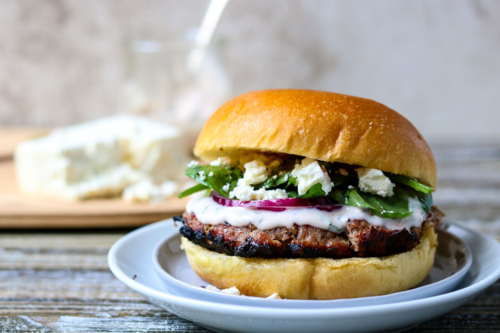 Grilled Greek Turkey Burger with Raspberry Mint Aioli on a plate