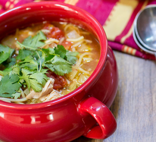 Slow Cooker Mexican Chicken Noodle Soup in a soup bowl