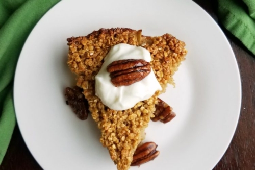 a slice of apple pie baked oatmeal on a plate