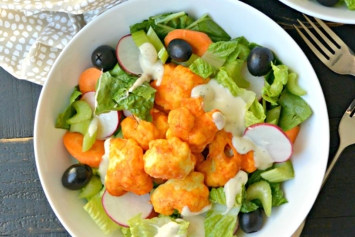 a bowl of Buffalo Cauliflower Bites Salad