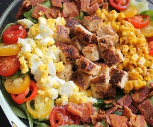 Cobb Salad with Honey-Mustard Ranch Dressing in a large bowl