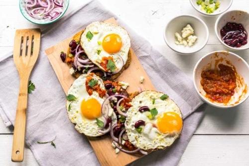 Huevos Rancheros Tacos on a wooden cutting board