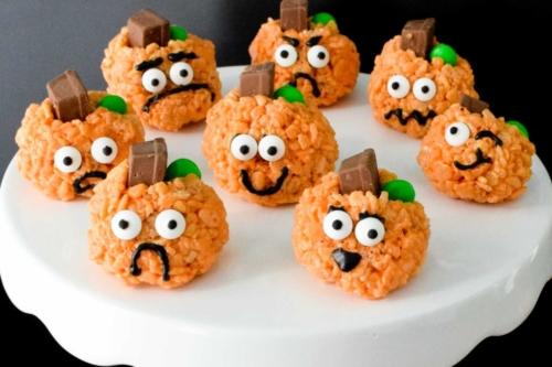 Rice Krispie Treat Pumpkins on a cake plate