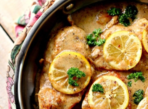 Creamy Lemon Chicken Breast topped with lemon slices