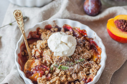 Peach and Plum Vegan Crumble in a fluted dish
