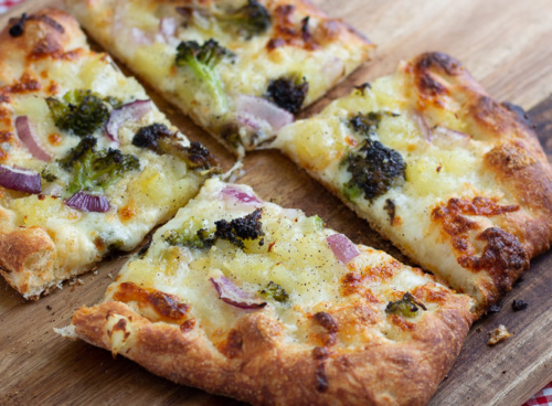 Pizza with Broccoli, Potato and Red Onions cut into 4 slices