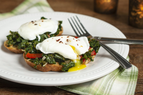 Poached Egg and Kale Toasts on a plate