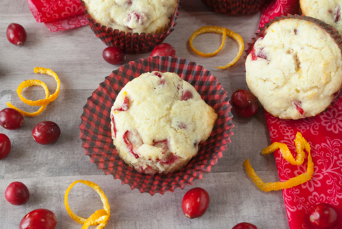 Cranberry Orange Muffins surrounded by fresh cranberries