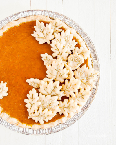 pumpkin pie with leaf crust decorations