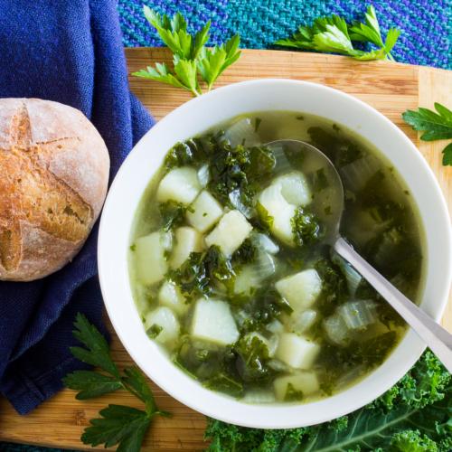 a bowl of kale potato soup