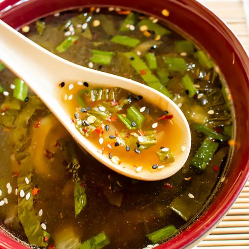 a bowl of bok choy soup