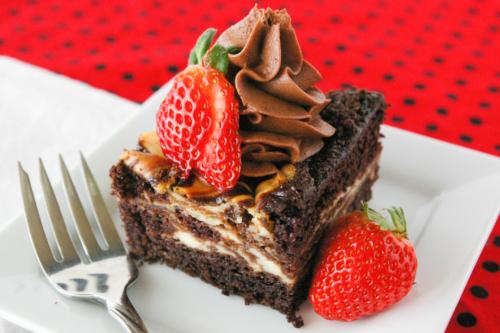 a slice of cheesecake swirled chocolate cake on a plate