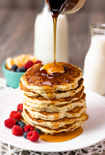 stack of pancakes with dripping syrup