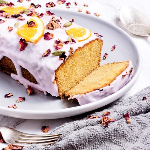 orange cardamom cake on a plate