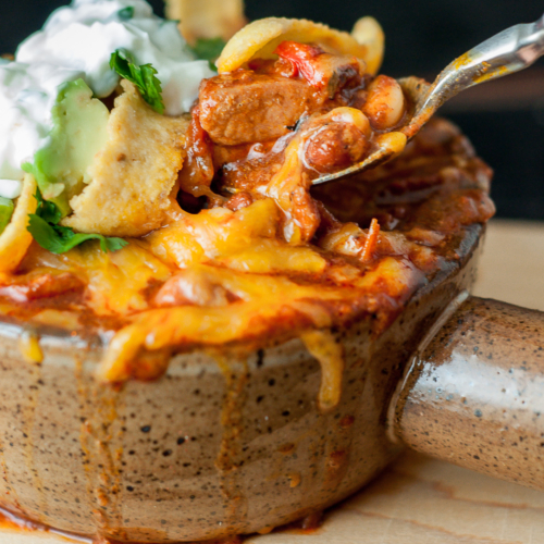 a bowl of cheesy chorizo chicken chili