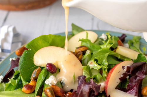 Apple Pecan Salad with maple vinaigrette on a plate
