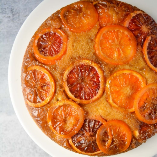 a cake covered with slices of blood oranges