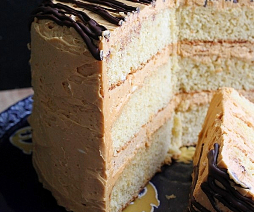 layered caramel honey cake with a slice on the side