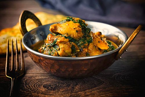 chicken saag in a serving bowl