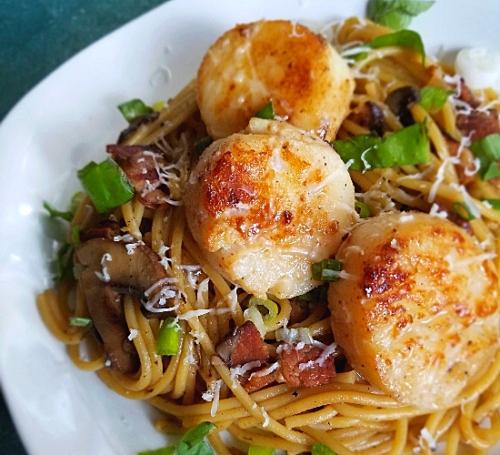 scallops over spaghetti