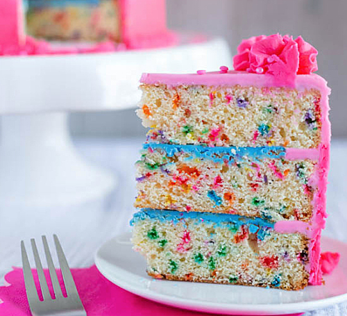 a slice of Funfetti Cake on a plate