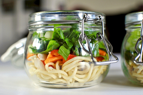 noodles and veggies in a glass jar