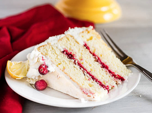 a slice of Lemon Cranberry Cake on a plate