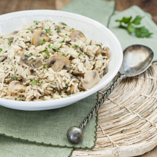 a bowl of rice and mushrooms