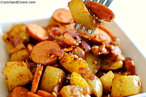cubed potatoes and sliced smoked sausage in a bowl