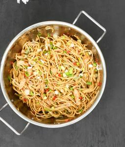 chicken chow mein in a colander