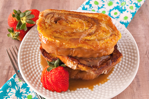Cinnamon Swirl French Toast topped with caramel syrup