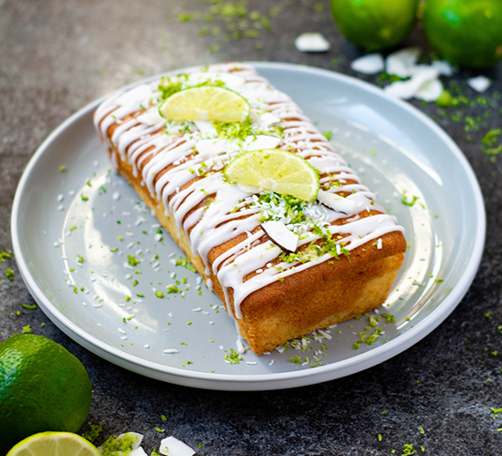Tangy lime drizzle cake topped with a sweet limeade coconut icing