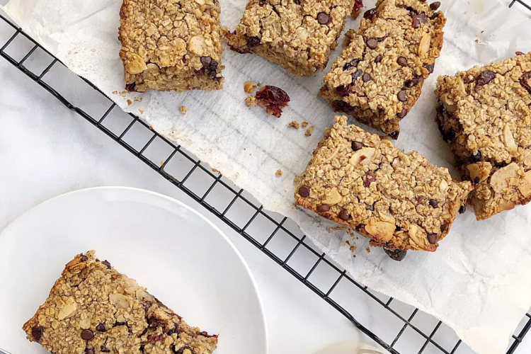 oatmeal bars on a cooling rack and a plate