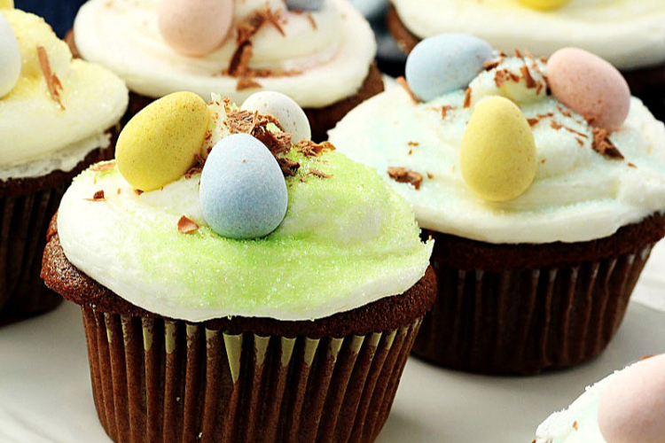 Easter Cupcakes topped with colored candied eggs