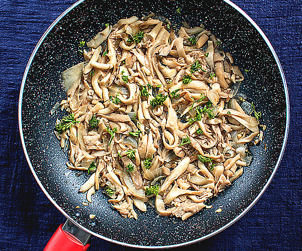Sauteed Oyster Mushrooms in a skillet