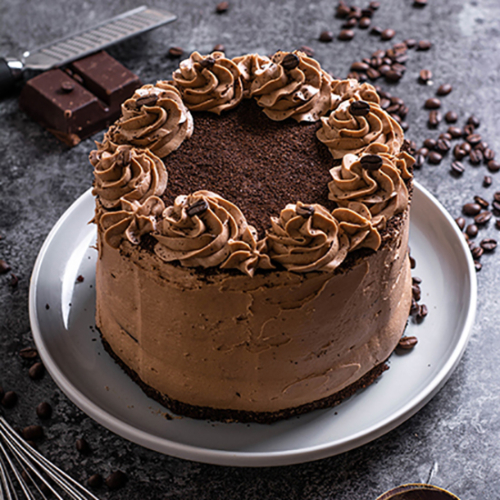 round chocolate cake with fancy chocolate frosting