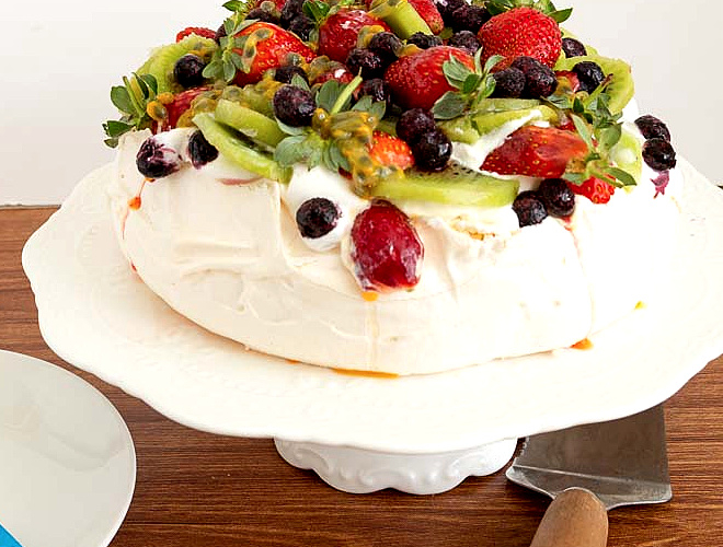 pavlova topped with berries and fruit