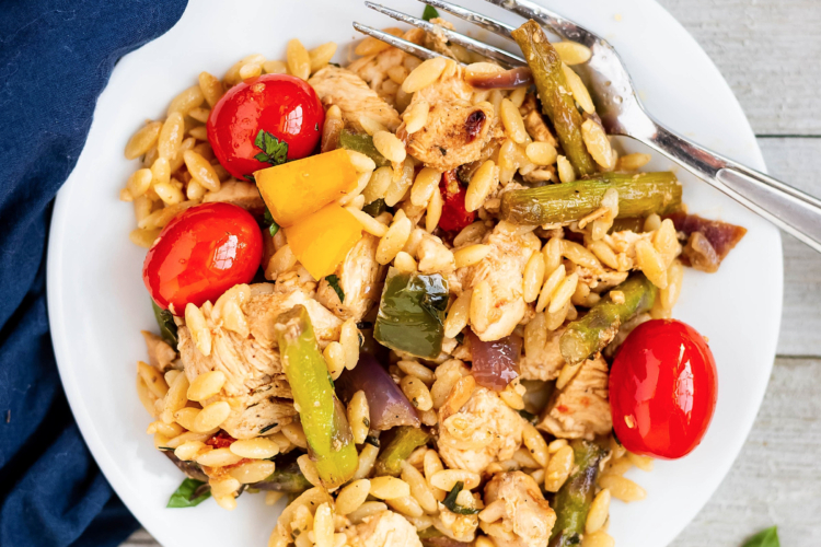 chicken, vegetables and orzo on a plate